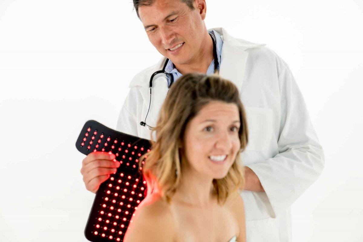 Inlight Therapy Inc. LED light therapy pad in use on the back