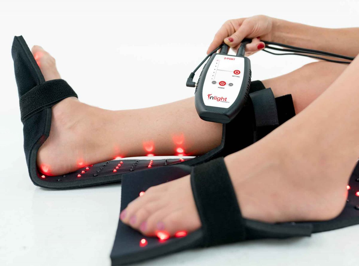 Inlight Therapy Inc. LED light therapy pad in use on the feet