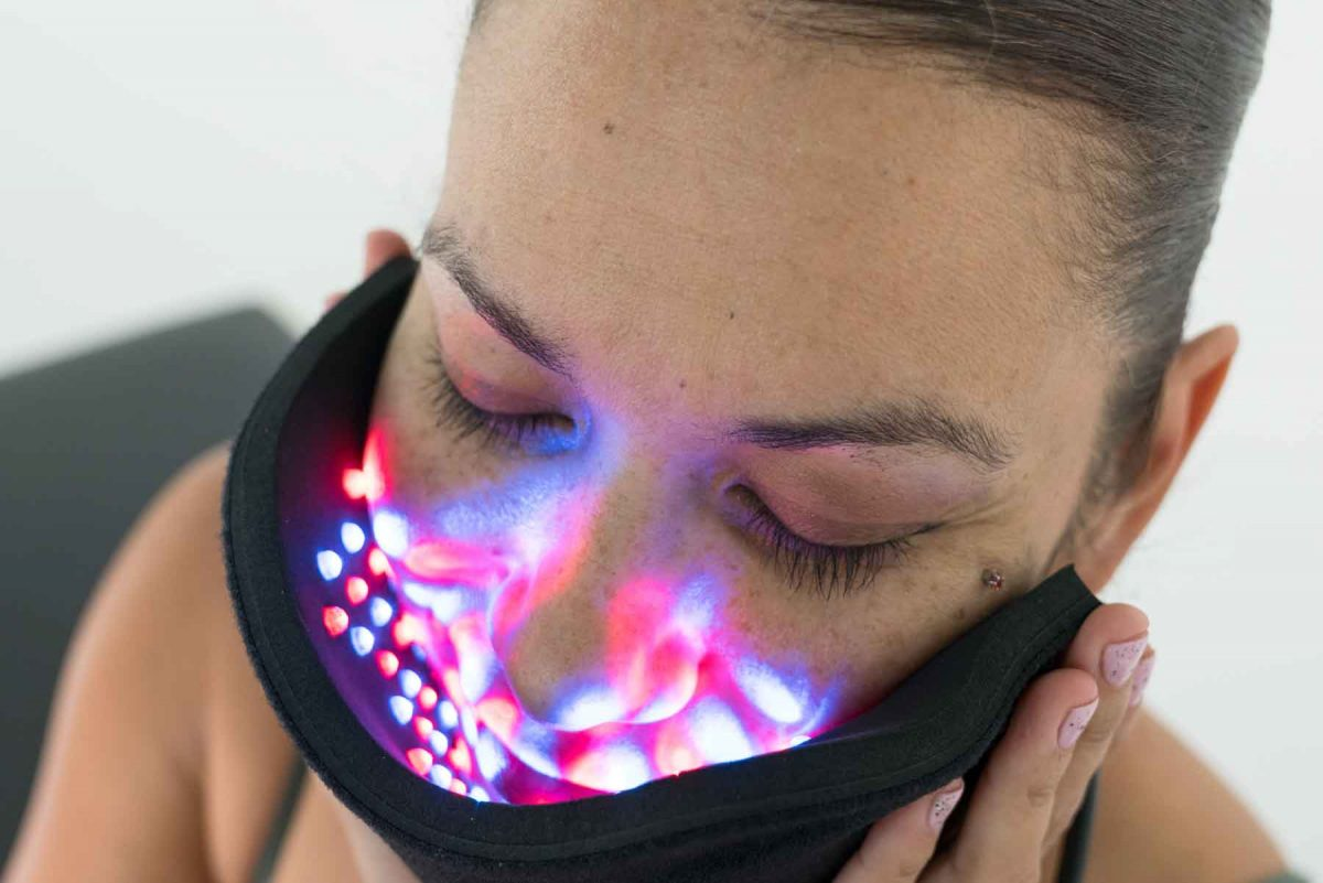 Inlight Therapy Inc. LED light therapy pad in use on the face